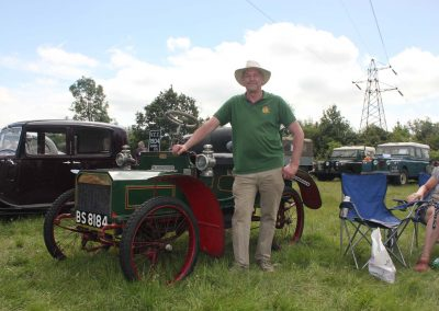 A proud owner with his vintage vehicle