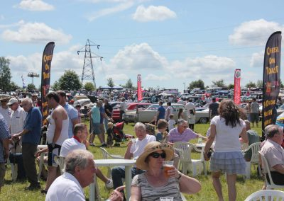Soaking up the sun with a pint at the 2014 classic car rally